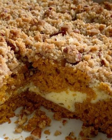 Cream Cheese Pumpkin Coffee Cake | Pumpkin Recipe | Coffee Cake | Pumpkin Coffee Cake with a sweet cream cheese filling and a brown sugar pecan streusel topping. Pumpkin Coffee Cake is so moist, delicious, and the perfect pumpkin recipe. #pumpkinrecipes #coffeecake #dessertrecipes #recipeoftheday #pumpkincake