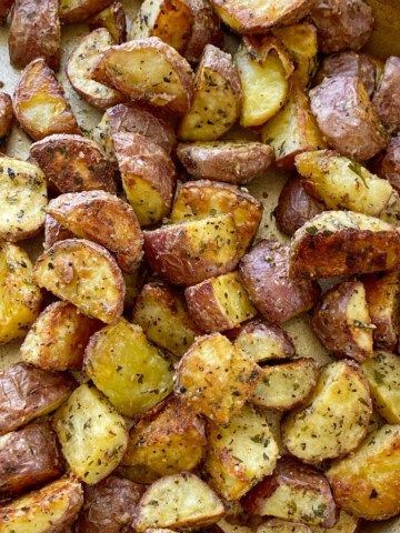 Roasted Red Potatoes | Side Dish Recipes | Roasted Vegetables | Red Potato Recipe | Roasted Red Potatoes are roasted to crispy perfection in the oven with olive oil, parmesan cheese, and seasonings. Roasted potatoes are an easy side dish.