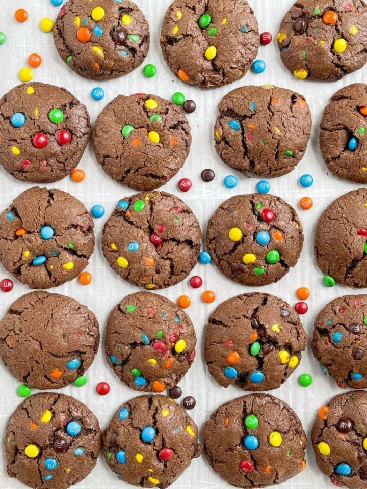 Overhead shot of a cookie tray of chocolate m&m cookies.