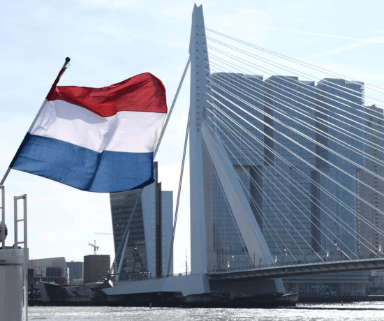 Rotterdam Erasmusbrug with the Dutch flag during the summer