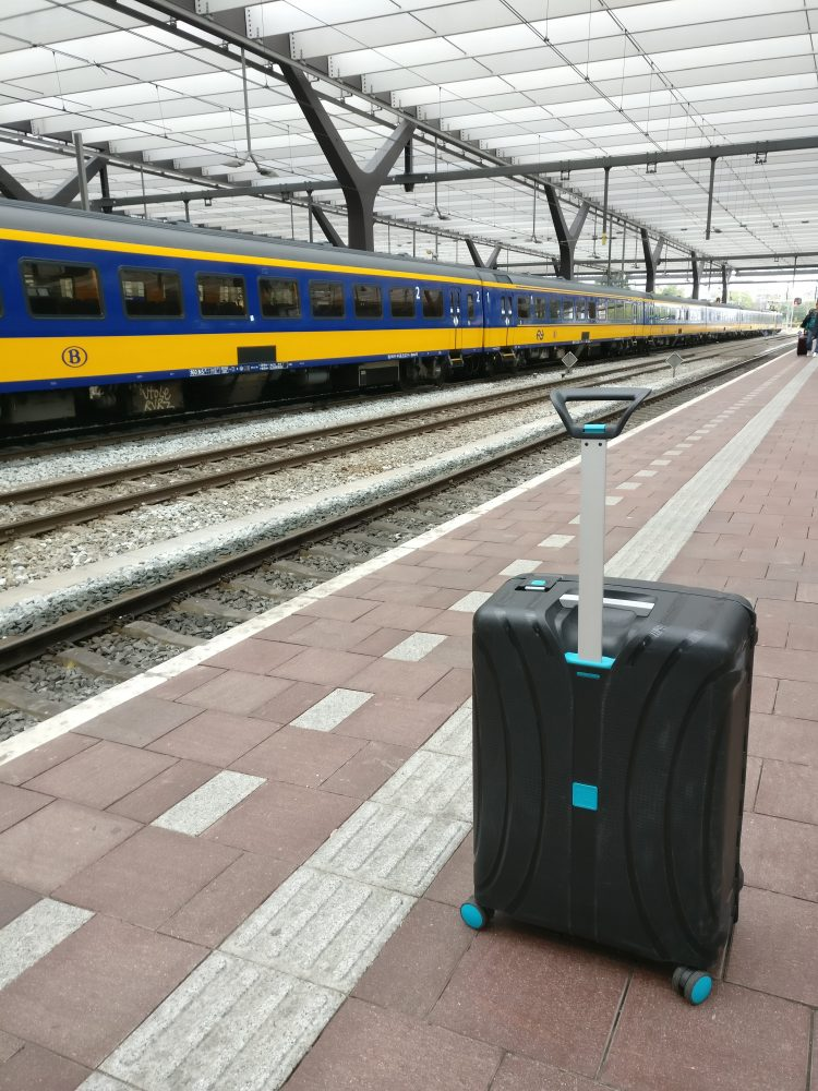 A suitcase and a NS Train at Rotterdam Centraal Station