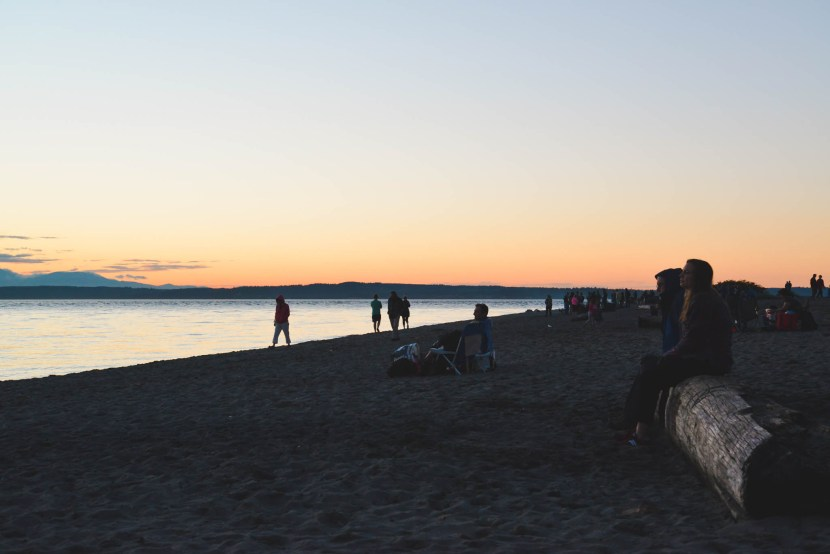 The locals gather on the beach of Golden Gardens Park for the best sunset in Seattle