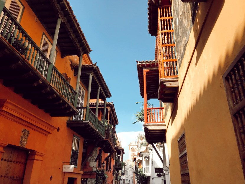 A street in Cartagena, Colombia lined with colorful houses and balconies
