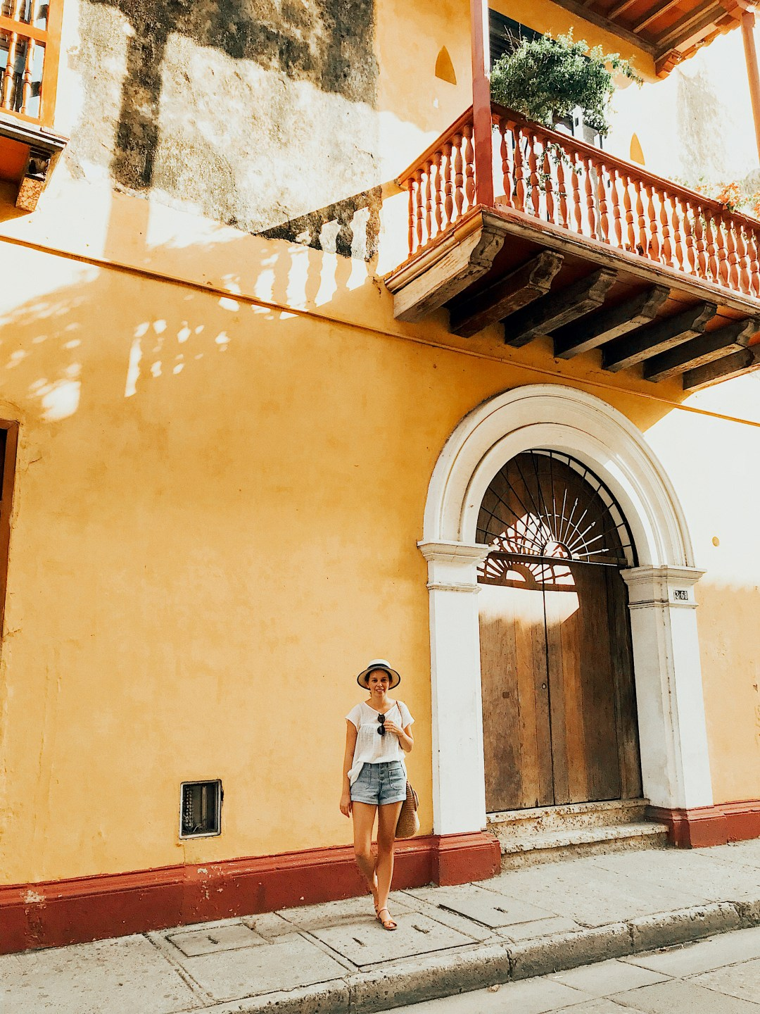 A colorful yellow home with a balcony in Cartagena, Colombia