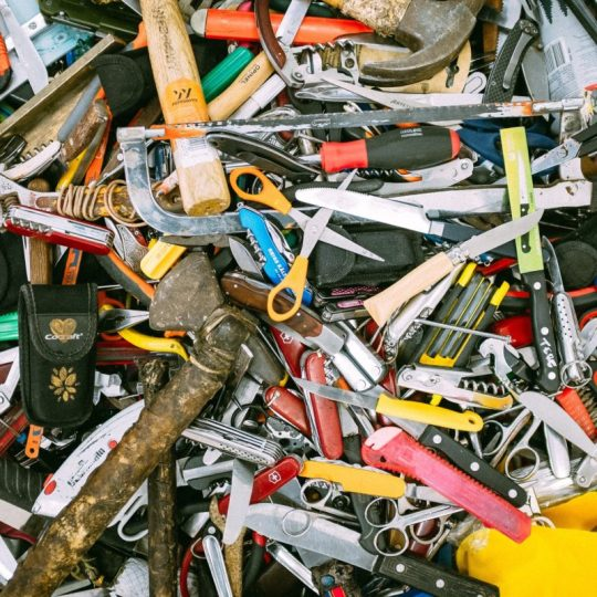 A pile of many many different maker tools (hammers, scissors, etc.)
