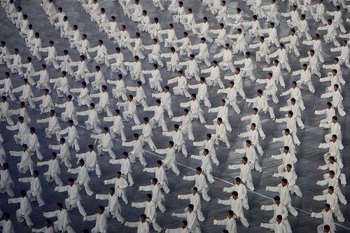 BEIJING - AUGUST 08: Martial artists perform Kung Fu during the Opening Ceremony for the 2008 Beijing Summer Olympics at the National Stadium on August 8, 2008 in Beijing, China. (Photo by Mike Hewitt/Getty Images)