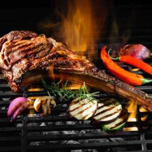 Tomahawk rib beef steak on grill