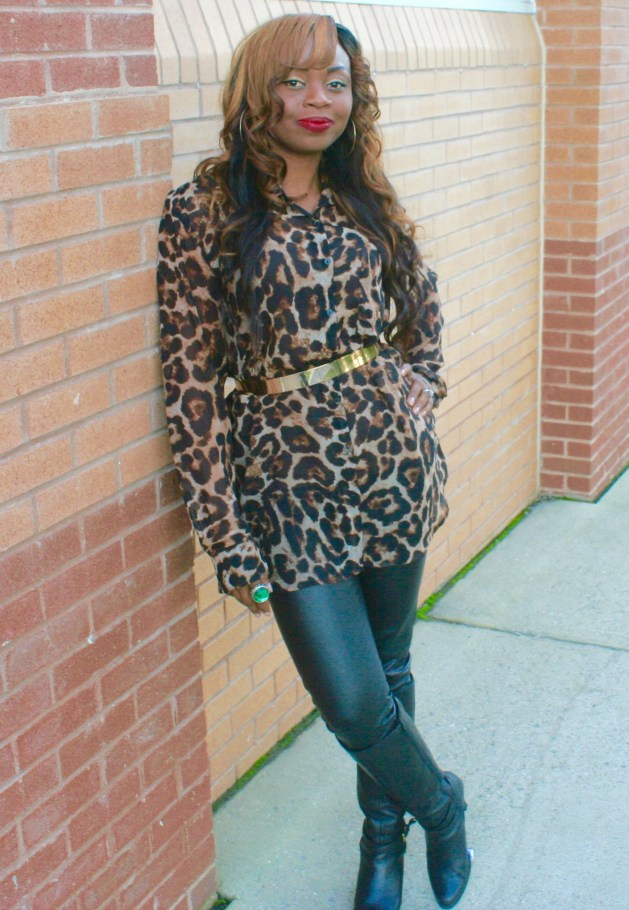 Long sleeve animal print top, gold belt and black leather pants