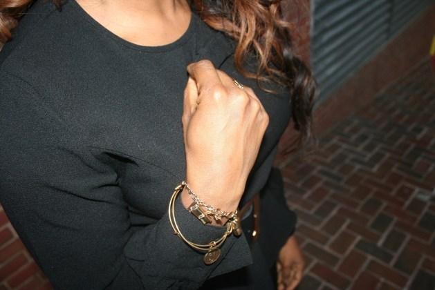 Black peplum top with Alex and Ani bracelets and Kate Spade bracelets
