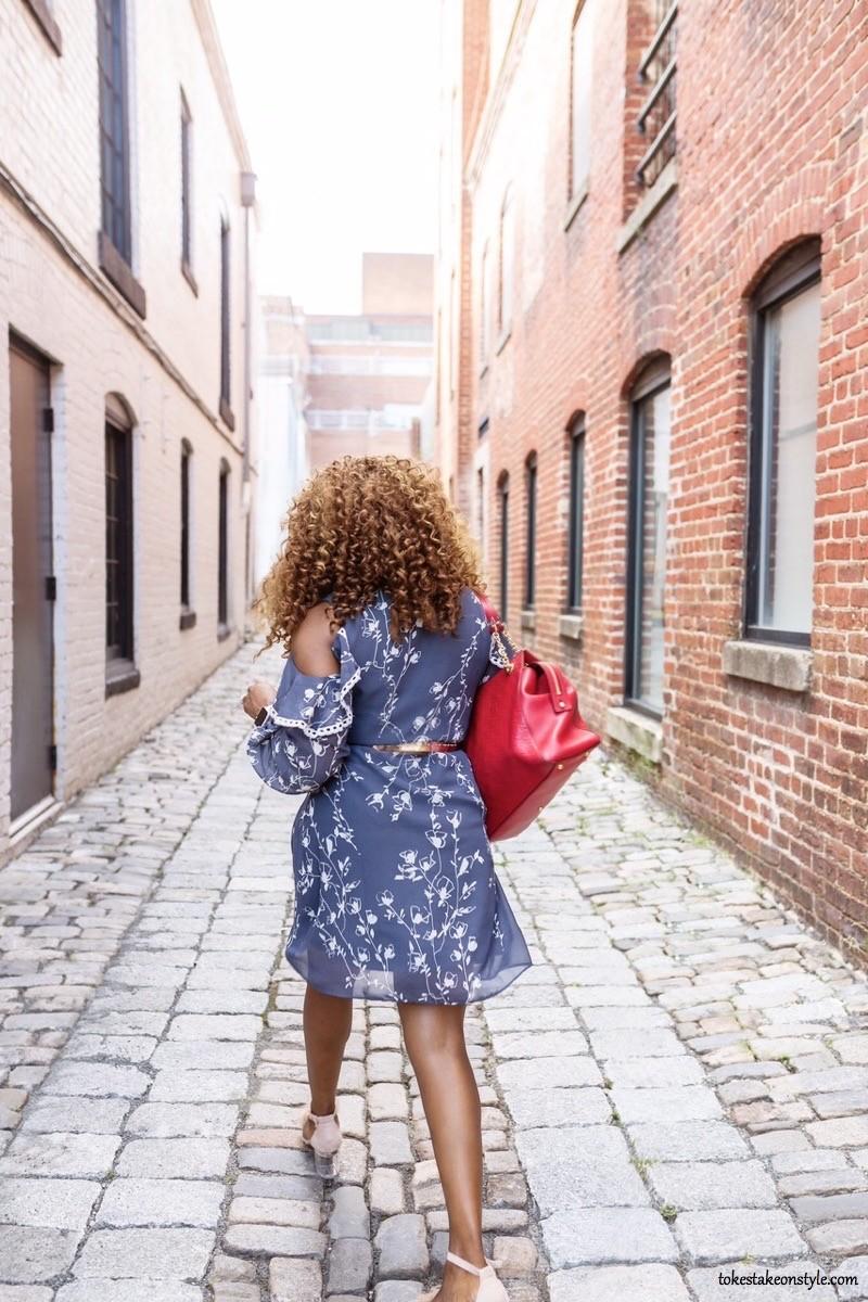 woman walking in cold shoulder dress
