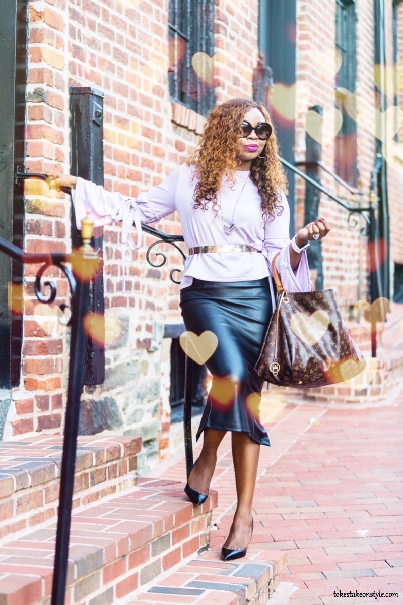 Fashion blogger with statement sleeves and a leather skirt