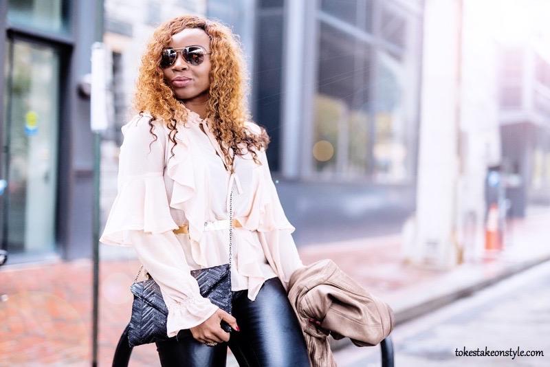 Fashion blogger in a ruffle top
