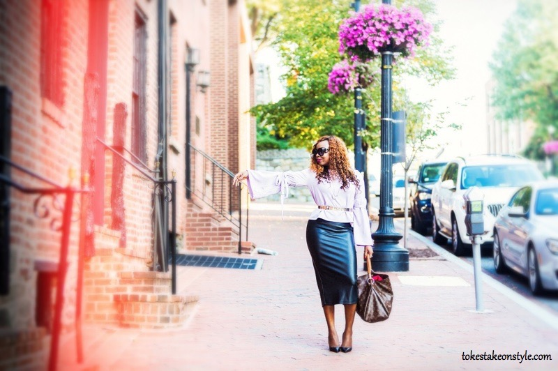 Fashion blogger in statement sleeves and leather skirt
