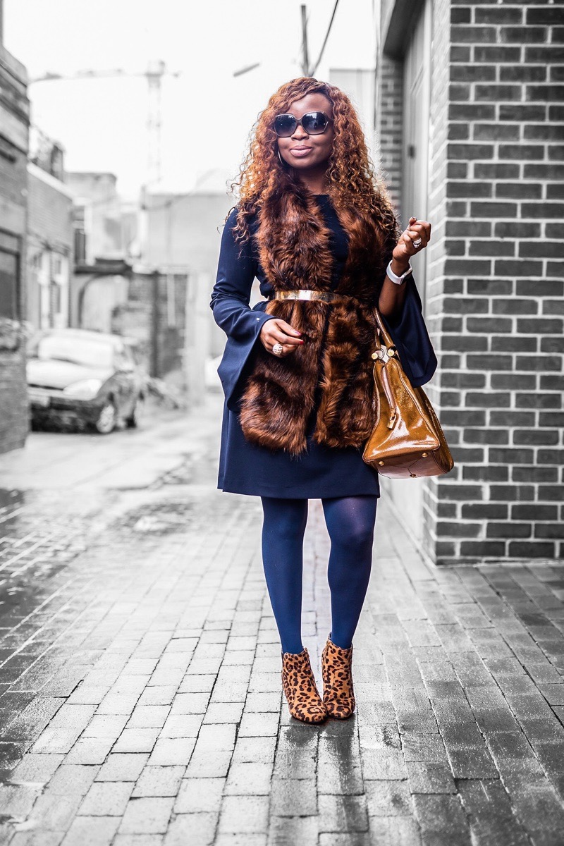 Woman in a faux fur outfit with leopard boots