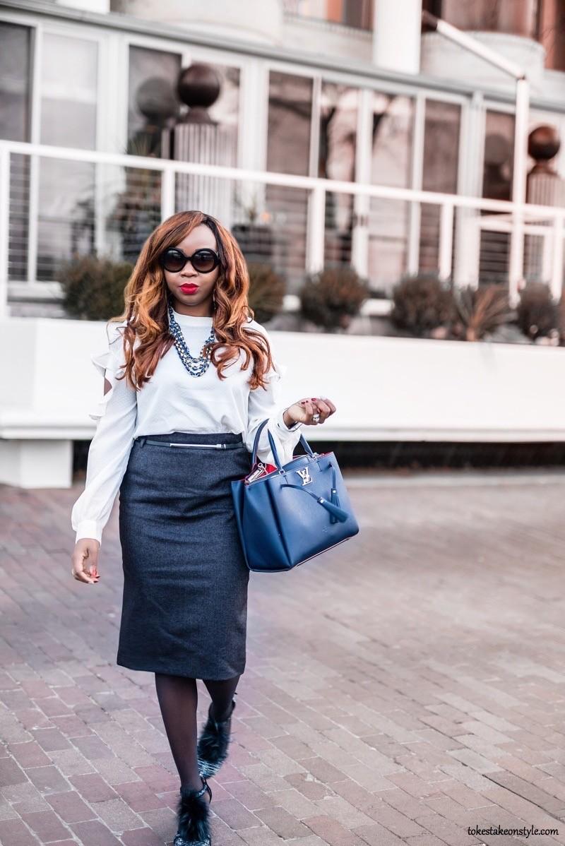 Woman with blue Louis Vuitton Lockmeto bag