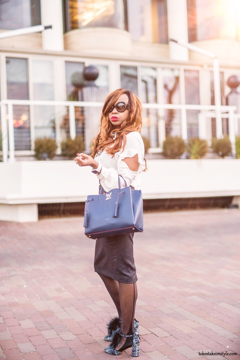 Lady with Louis Vuitton Lockmeto bag and Bettye Muller pumps