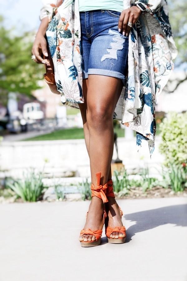 Blogger wearing orange wedge sandals
