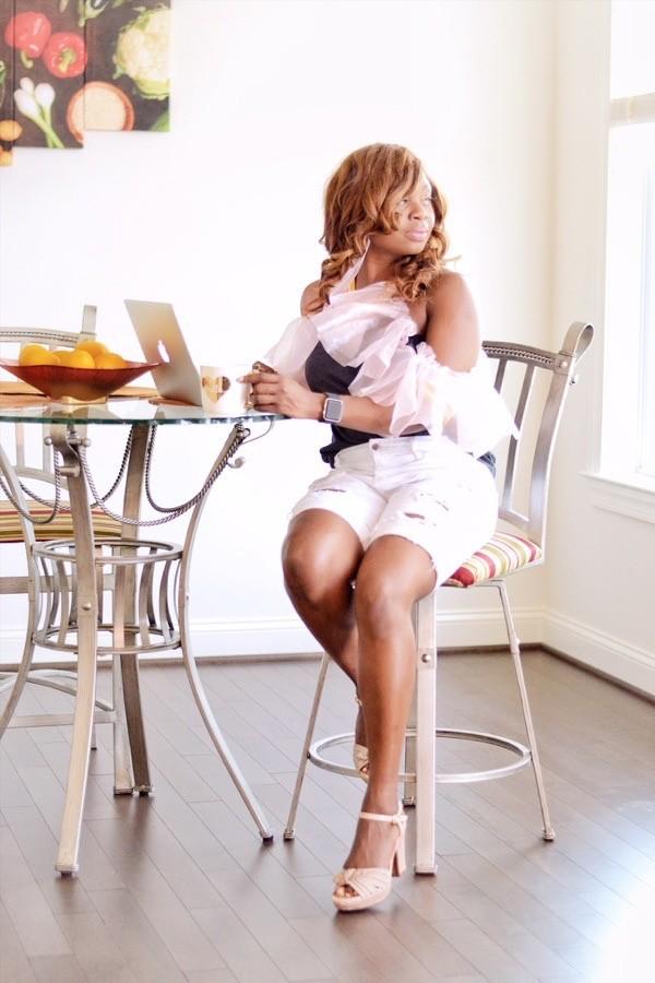 Blogger wearing white denim shorts