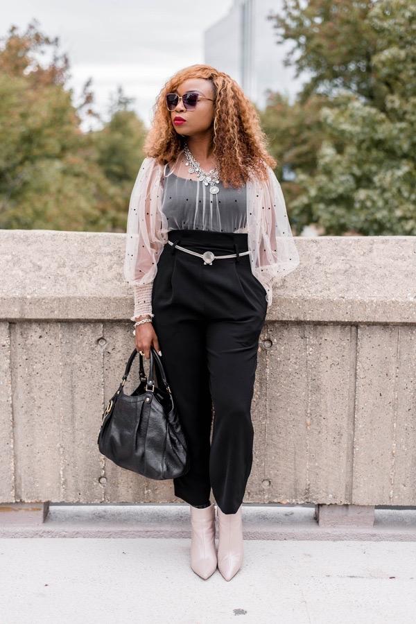 black lady in sheer long sleeve pink top
