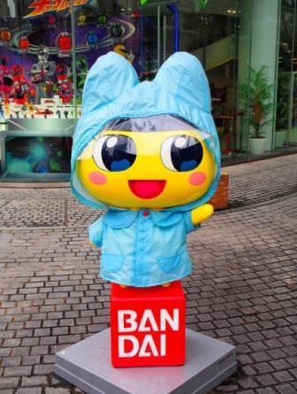 Mametchi in Bandai Headquarters, Tokyo, Japan, in raincoat