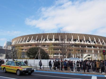 yellow taxi and tokyo olympic stadium