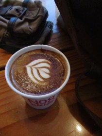 Latte art in a paper cup at No. 8 Bear Pond Espresso Shibuya Tokyo Japan