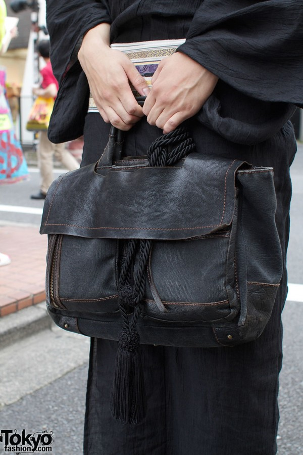 Leather bag with black tassel