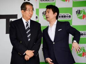 Strange bedfellows: Osaka Mayor Toru Hashimoto (right) chats to fellow co-leader of the Japan Restoration Party Shintaro Ishihara in Tokyo in June. Hashimoto announced last month that Osaka Prefecture and city will jointly submit a proposal to the Cabinet Office to set up a Special Challenge Zone where some labor protections would be relaxed or waived.