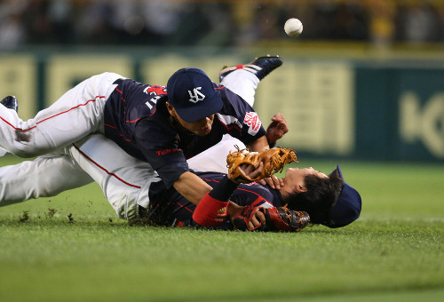 Yamada and Takeuchi collided on a defensive play in the seventh.