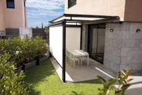 Toldo veranda sobre terraza vista lateral