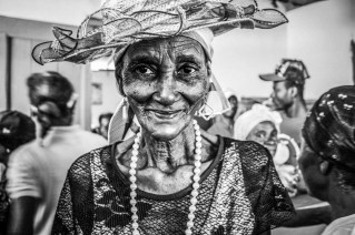 A village elder pauses to smile after performing an oral story about the history of her people. Of all the people in the room she was the most full of emergency, of life, and of grace. Her performance was thoroughly captivating, and though it was in another language, she had a way of making you feel, and somehow understand, what she was saying. All eyes were on her, the other village elders, all the volunteers, and some stray school children waiting beneath the open windows. I didn't have to say much to get this picture, just slightly lift my camera and she stuck her pose, and I am forever grateful I got to meet her.