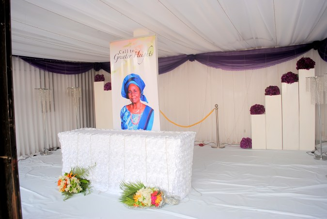 Mama was laid in state in an all white decorated room with purple floral tinge to it. it looked heavenly.....