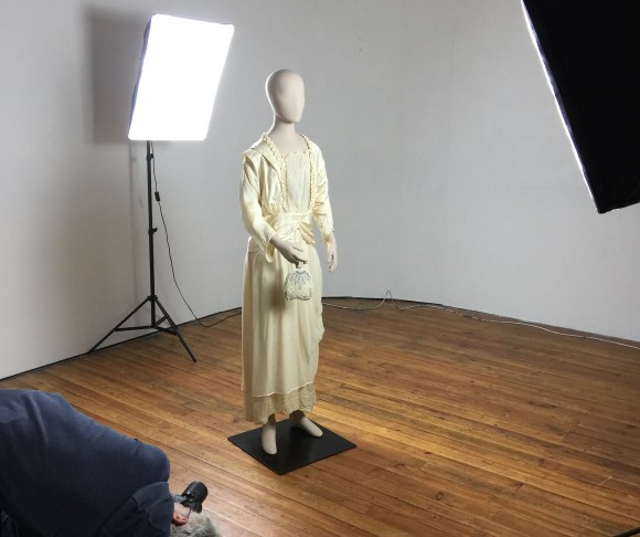 A volunteer photographs the dressed mannequin from every angle to ensure good coverage for photogrammetry