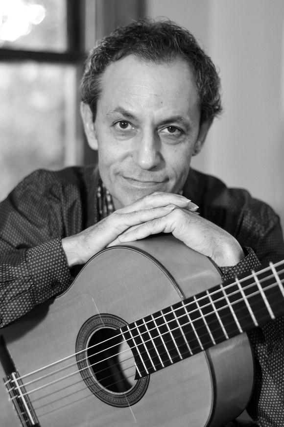 Portrait of Tomás Lozano with his Spanish guitar by Matt Jaskulski