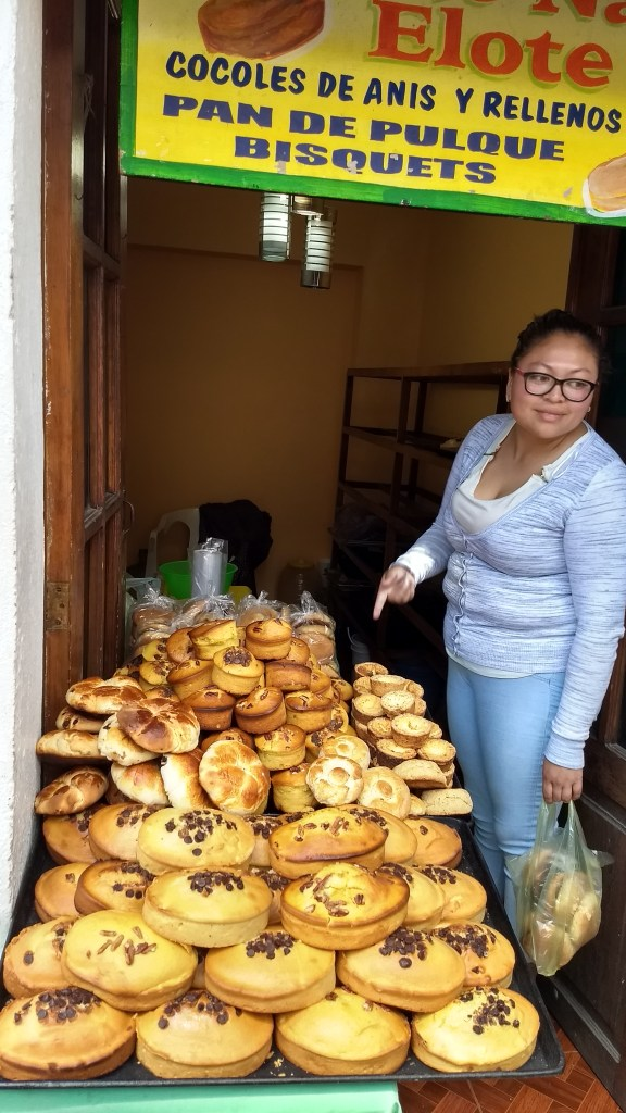 Vendor selling bread made with pulque
