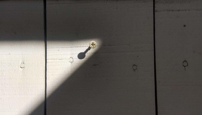 Unused screw on the wall