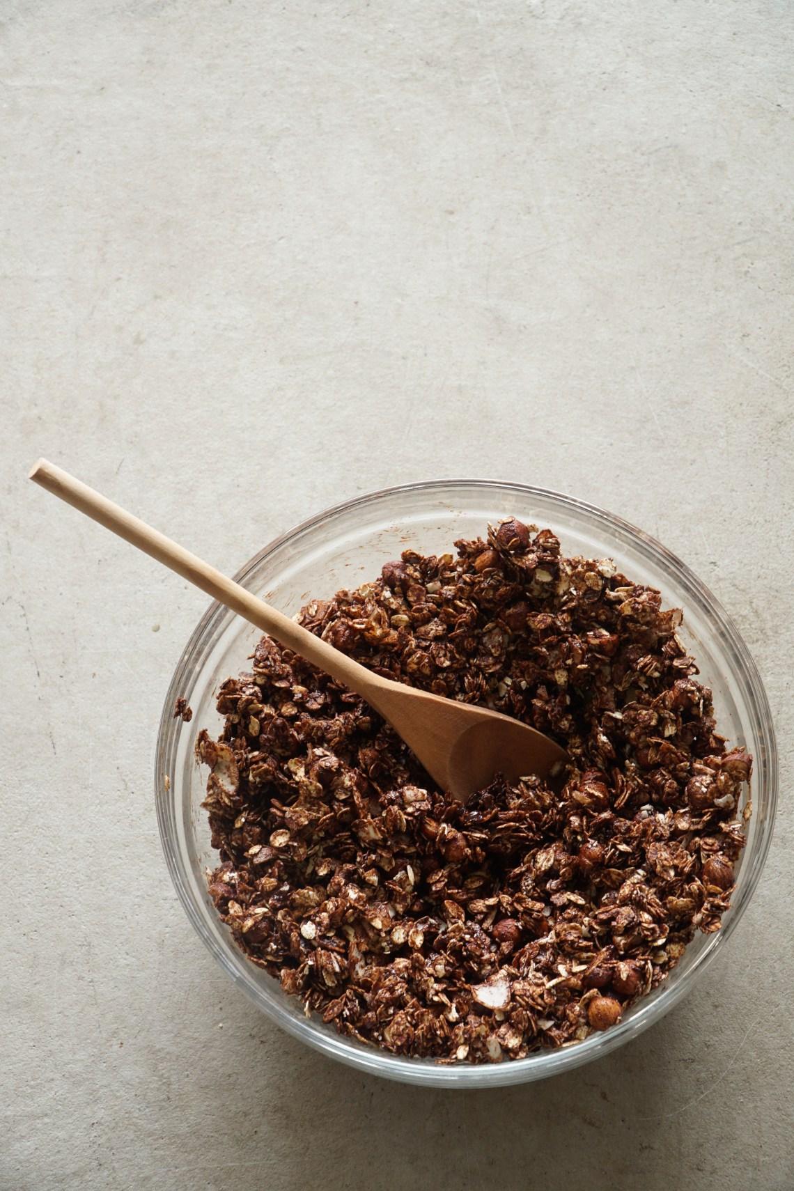 A mixing bowl with chocolate nd hazelnut granola.