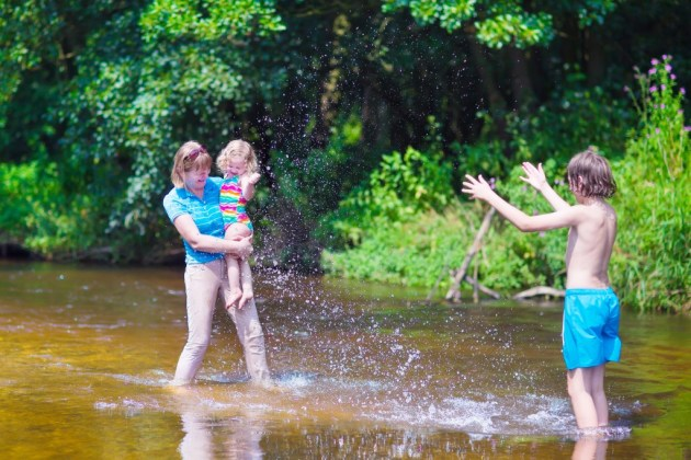 Family enjoying hot day on a river