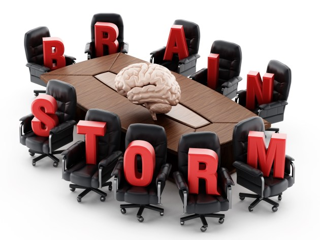Boardroom table with red brainstorm text isolated on white background