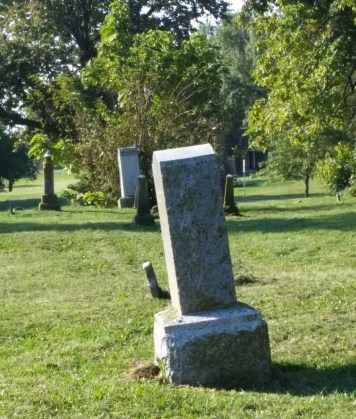 Leaning headstone in cemetery