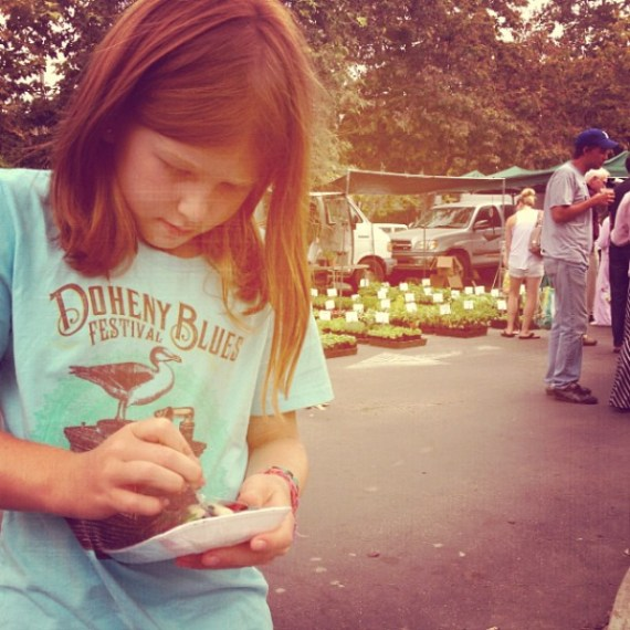 My daughter tearing it up at the #venicefarmersmarket. Feelin' groovy.