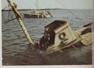 A view of the sinking Orca doing what it did best, from the back cover of The Making of the Movie Jaws.