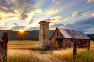 barn in the mountains during sunset
