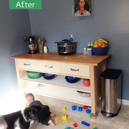 New kitchen counter, baby, and dog.