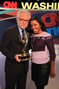 "CNN producer and FAMU alumna Rachael Shackelford and ""Situation Room"" host Wolf Blitzer display the Emmy trophy for""Outstanding Live Coverage of a Current News Story."""