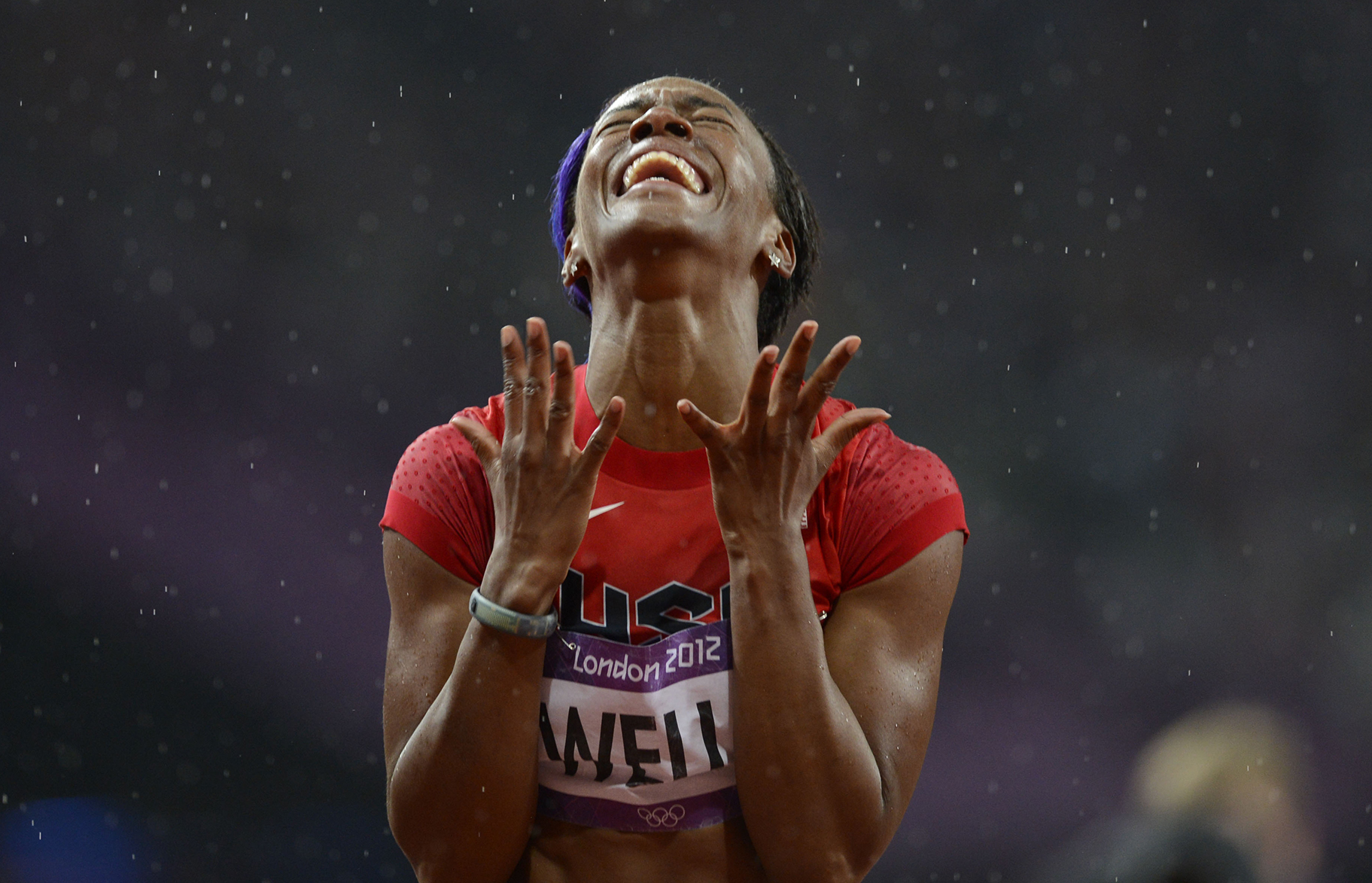 Aug 7, 2012; London, United Kingdom; Kellie Wells (USA) celebrates after winning the bronze in the women's 100m hurdles final during the London 2012 Olympic Games at Olympic Stadium. Mandatory Credit: John David Mercer-USA TODAY Sports