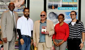 "Tom Joyner, center, and UVI President Dr. David Hall, left, presented UVI's 2012 scholarships recipients Mark Beverhoudt, at right, Kirwin Hodge, second left, and Latoya Benjamin, during the schools ""Fantastic Old School Reception"" for Joyner on March 19. Beverhoudt and Hodge are Hercules Scholars and Benjamin is a Tom Joyner Scholar."