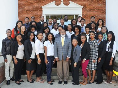 Tom Joyner Larkin with students