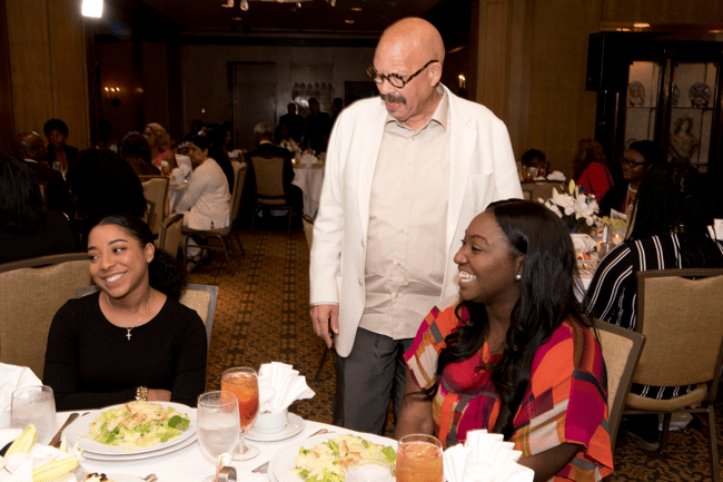 TJF Founder Tom Joyner with TJF volunteers, Kaila Gallimore (left) and Destiny McGee. (Photo: Jesse Hornbuckle)