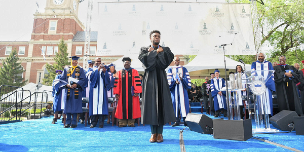 Chadwick Boseman greets the crowd with the Black Panther ͞Wakanda pose͟ during Howard University's 150th Commencement Ceremony on Saturday, May 12, 2018 in Washington, D.C. (Photo: Courtesy of Howard University)